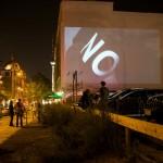 """09 Open Air Screening """"NO, Global Tour"""" von Santiago Sierra, Oranienburger Straße Berlin 2011"""
